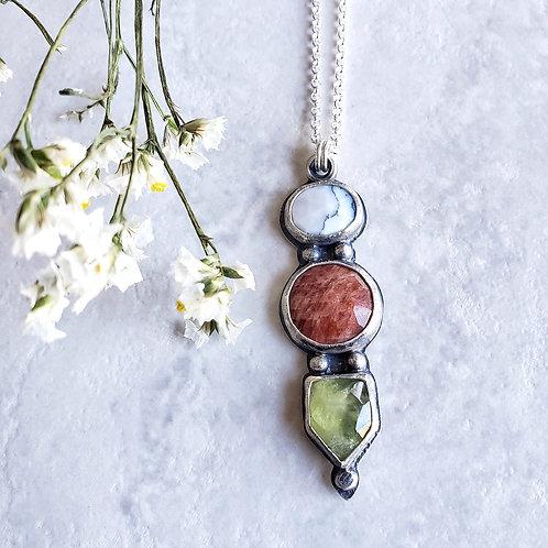 gem totem: white dendrite opal, sunstone, prehnite