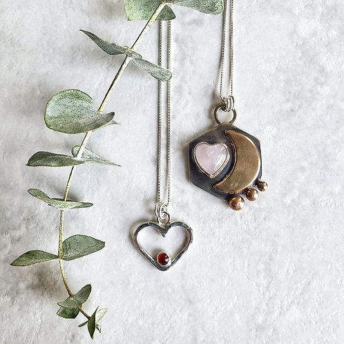 reserved: tiny open heart with carnelian