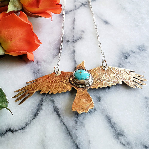 brass raven with turquoise