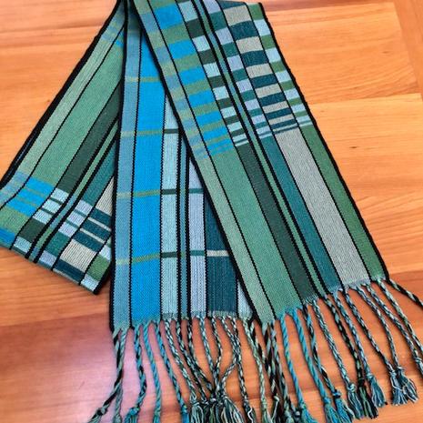 "Double sided tencel scarf.  6""x62"" plus 5"" fringe.  $90"