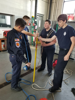 Jr. Firefighter training with tools