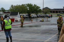 Jr. Firefighters training with hose