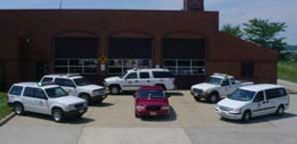 Staff vehicles in front of fire station