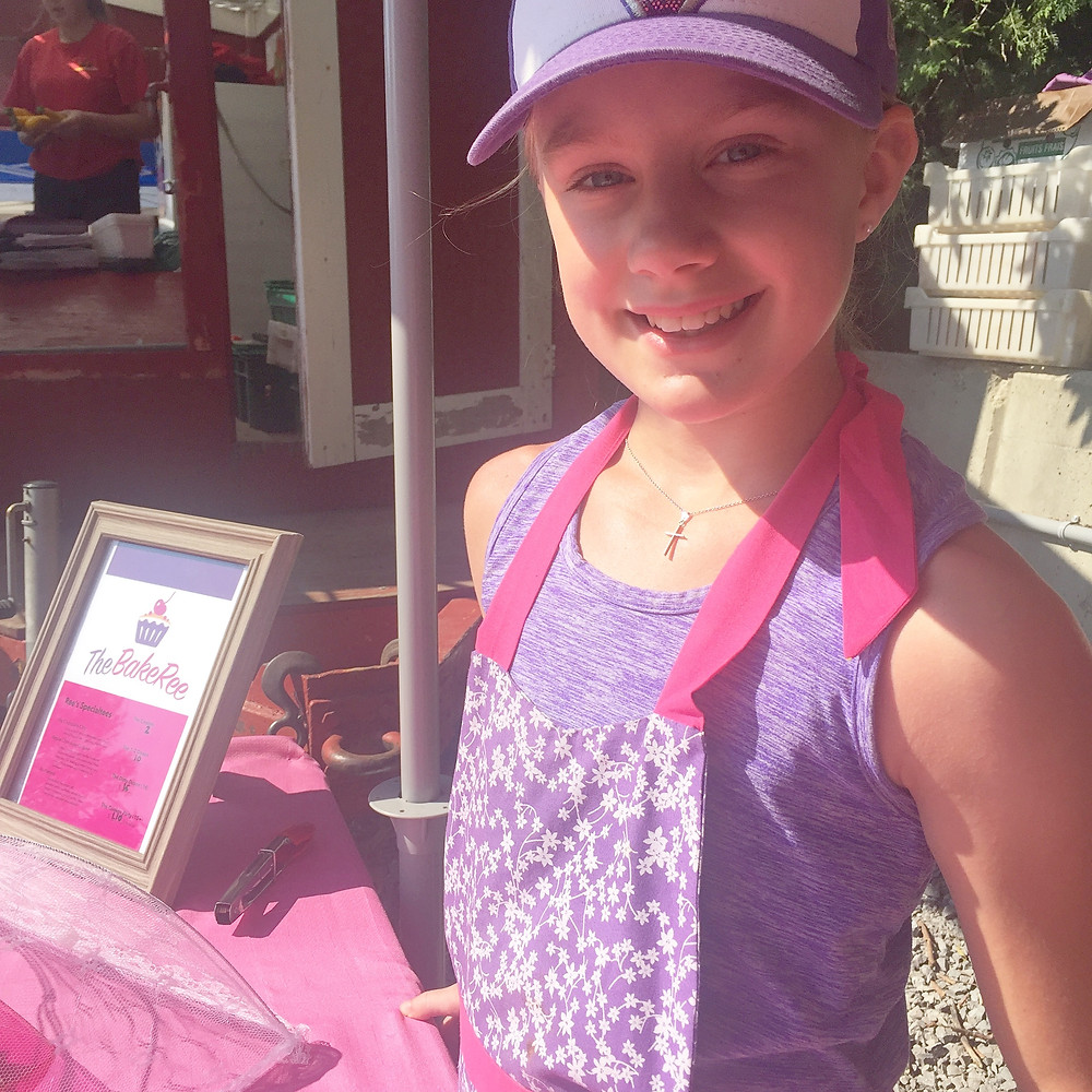 The BakeRee's Regan Scott in her apron and Toronto Blue Jays cap