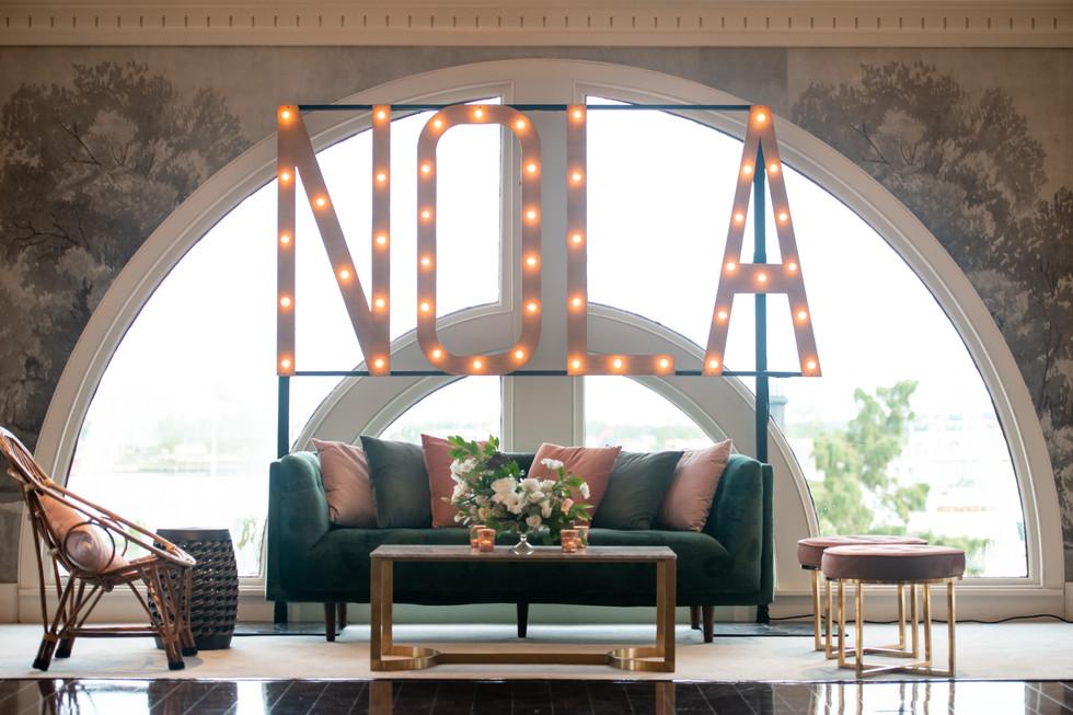 NOLA Sign/Riverview Room