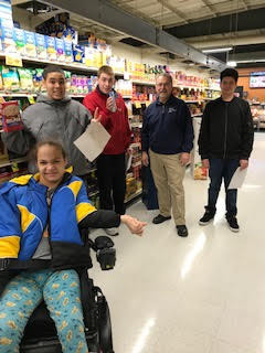 Photo of students from the Life Skills program at Big Bunny Supermarket. BIg Bunny owner Pete Cournoyer is also in the photo.