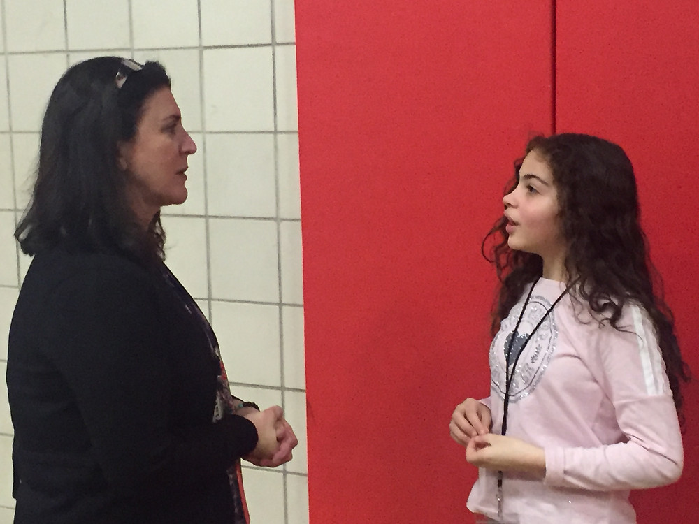 Photo of a student talking to an adult at Charlton Street School