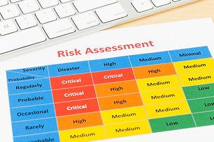 Risk management matrix chart with pen an