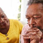 Senior Woman Comforting Man With Depress