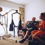Two homecare nurses at an elderly mans h