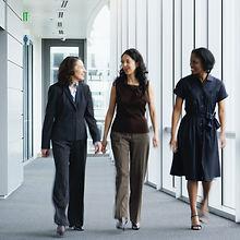 Businesswomen Walking in Hallway_edited.