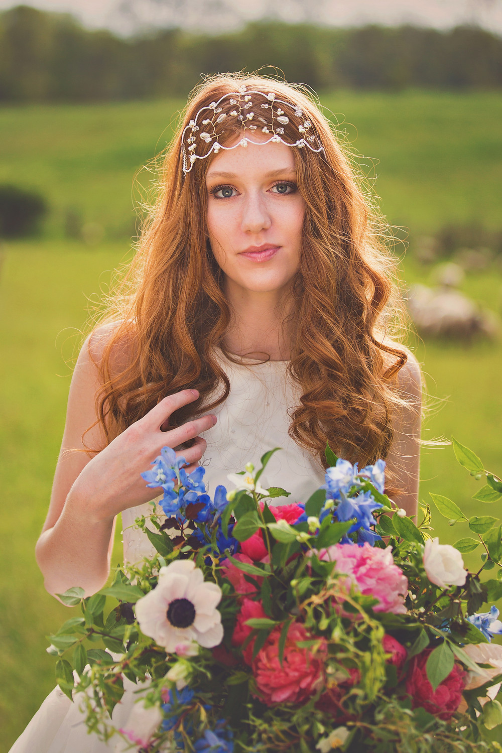 Bride with summertime floral bouquet