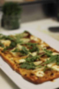 House Made Flatbread/Confit Garlic Cream/Bartlett Pear/Chevre/Prosciutto/Balsamic Gastrique/Rocket