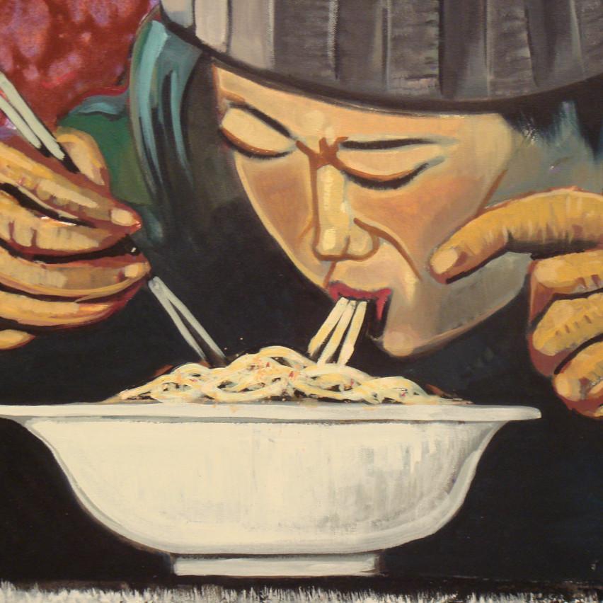 Xines menjant fideus