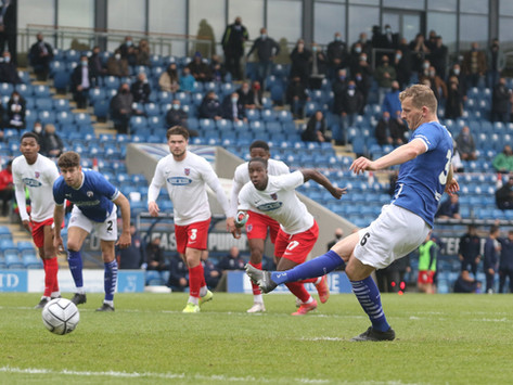 Rowe's double keeps Spireites' play-off hopes alive