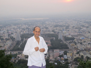 On Arunachala with Arunachaleswar Temple below as sun rises
