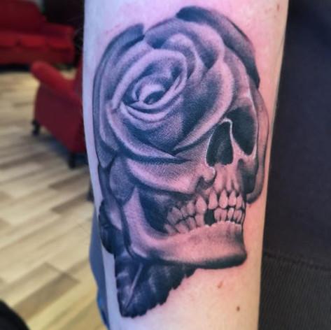 Black and Grey Skull Rose Morph Tattoo