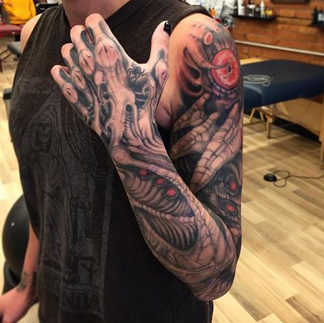 Black and Grey Biomech Sleeve Tattoo