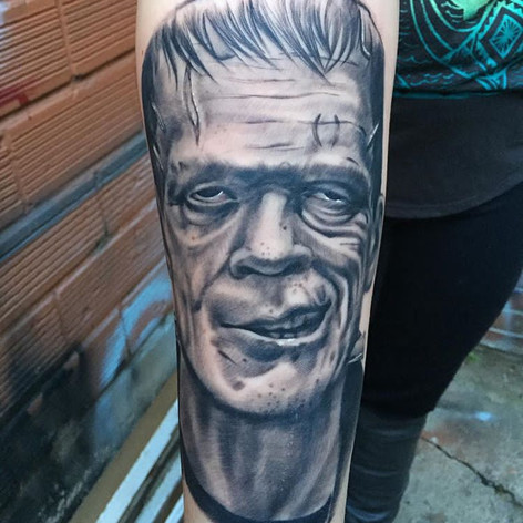 Black and Grey Frankensteins Monster Tattoo