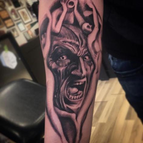 Black and Grey Freddy Krueger Tattoo