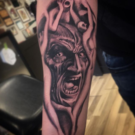 Black and Grey Freddy Krueger Tattoo