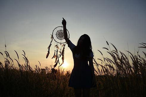 Woman holding dream catcher.jpg