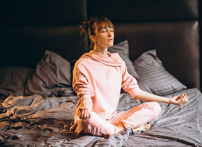 Woman doing yoga in bed.jpg