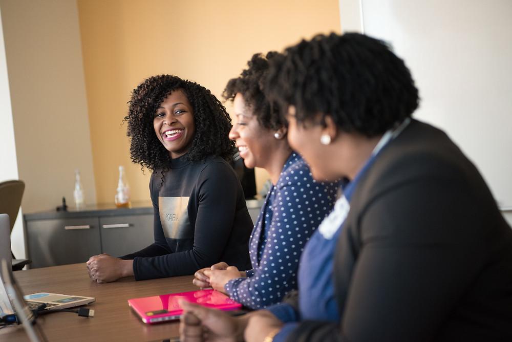 Black business women working at desk together