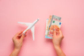 bigstock-Plane-And-Money-In-Hand-On-A-P-