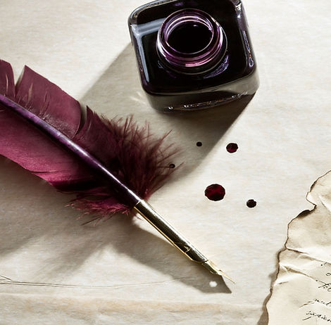 feather-pen-writing-letter-with-ink-bott
