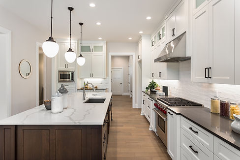 A designed kitchen with wooden floor