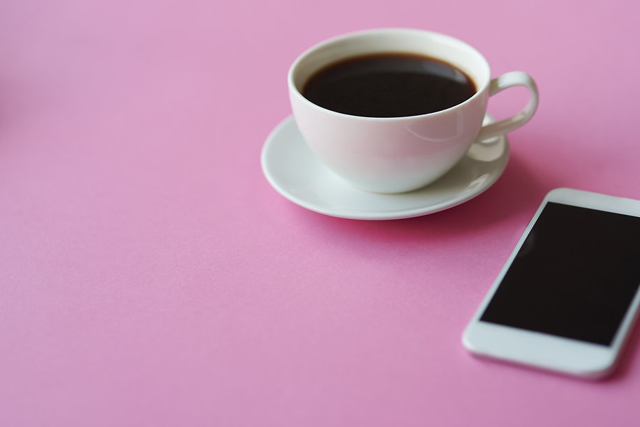 close-up-of-black-coffee-and-smartphone-