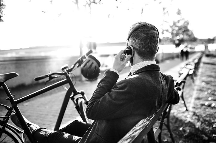 businessman-commuter-with-bicycle-sittin