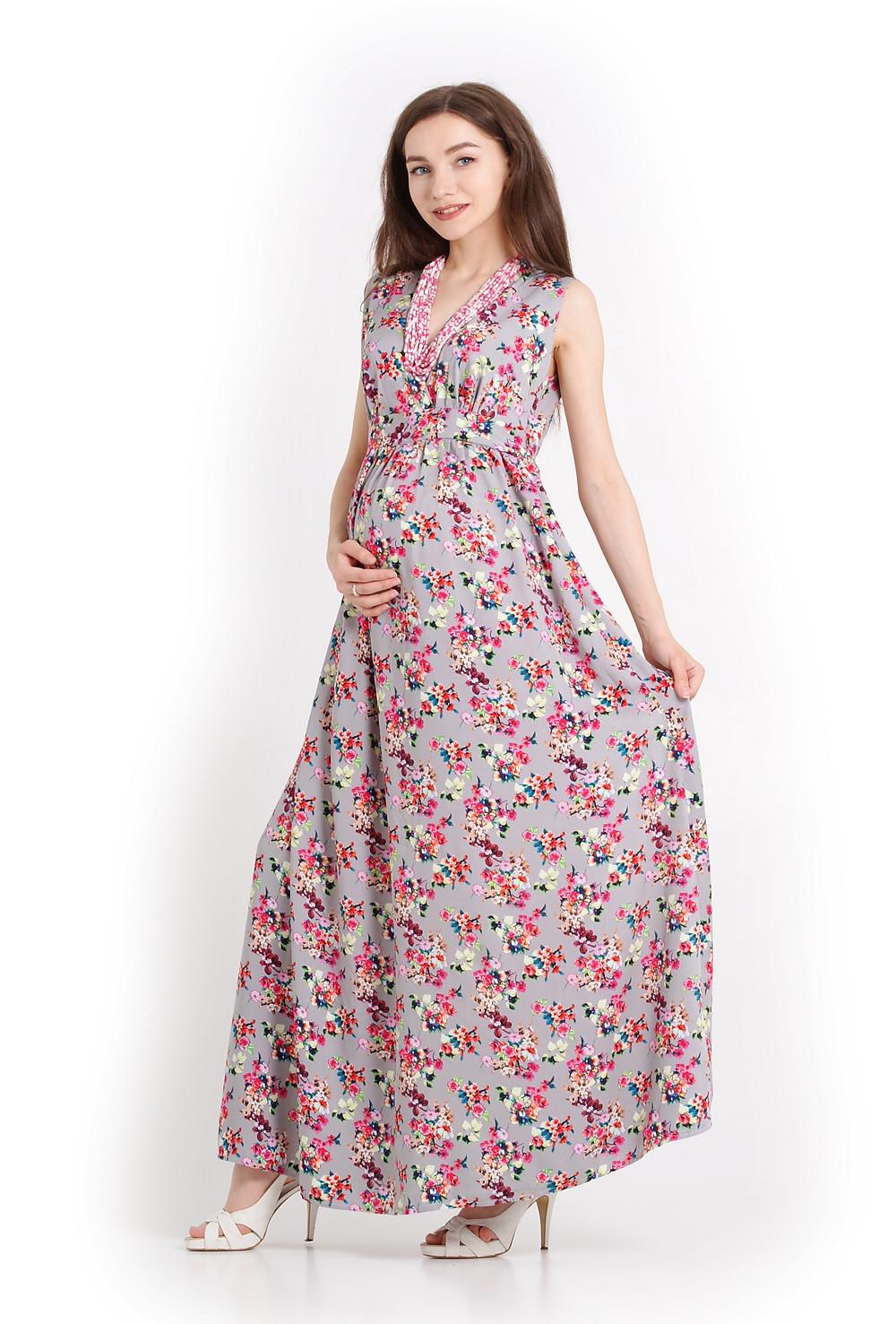 Сукня для вагітних з натуральної тканини, що струменить навколо фігури, робить силуєт стункішим й підкреслює жіночі обриси
