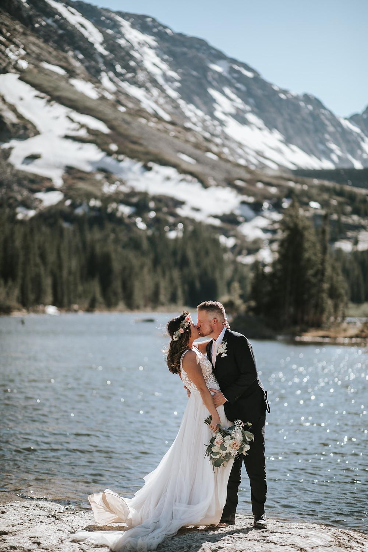 Breckenridge, Colorado elopement couple sharing a big kiss at Blue Lakes