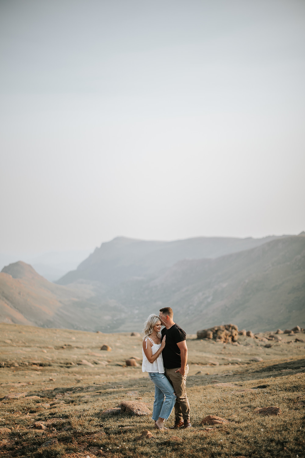 Pikes Peak Highway elopement couple sharing a hug together at the top of the mountain