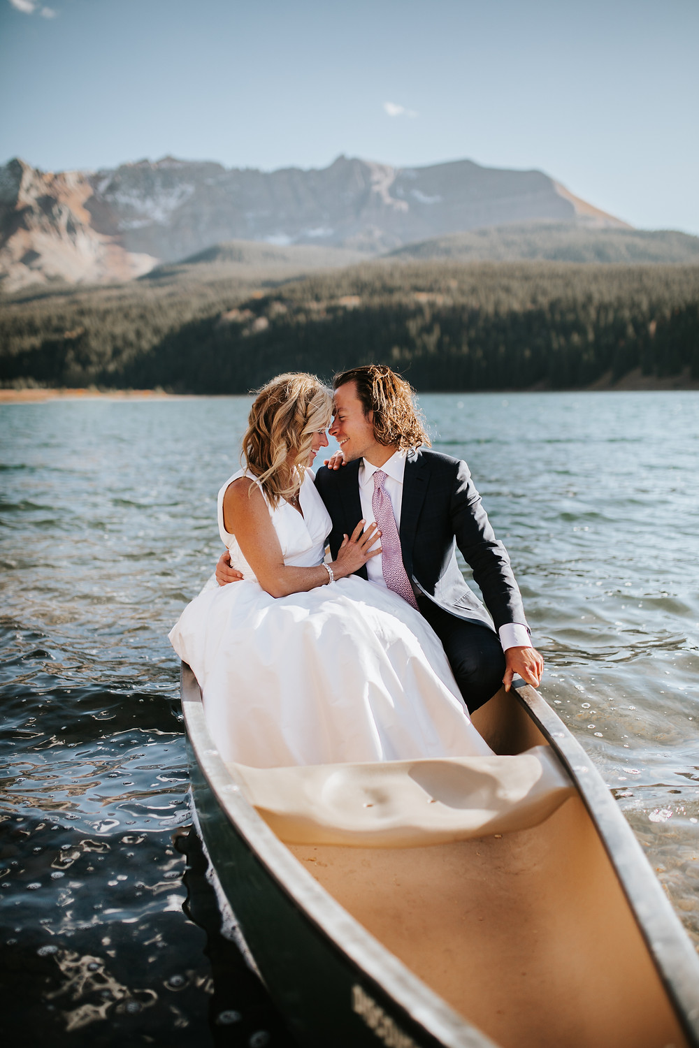 Elopement couple sitting in a canoe at Trout Lake in Telluride, Colorado