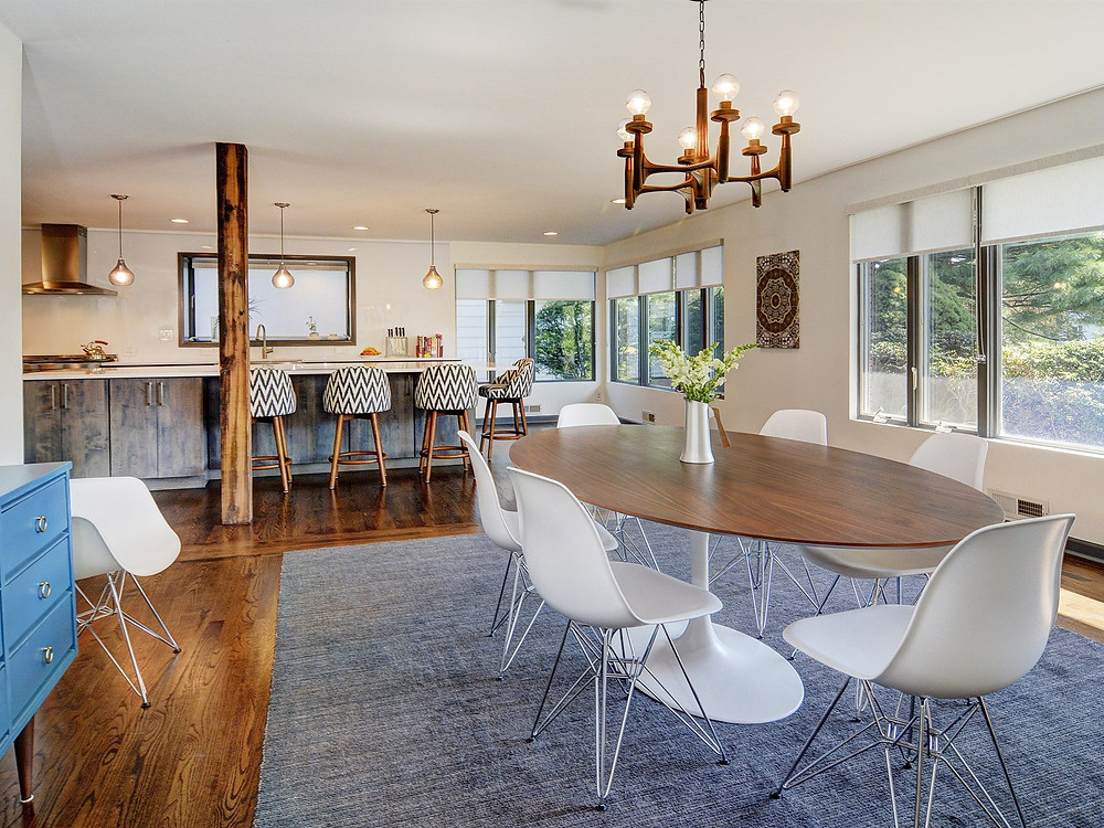 Open concept mid-century home in South Orange, NJ. Dining room opens to kitchen. Beam is supported by a column.
