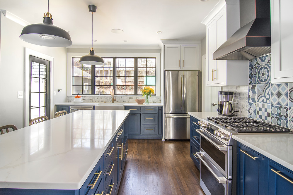 Blue Kitchen in Maplewood, NJ with blue base cabinets, white wall cabinets, striking wall tile, industrial casement windows.