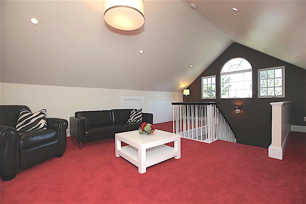 Bright red carpet, new stairway and Palladian window.