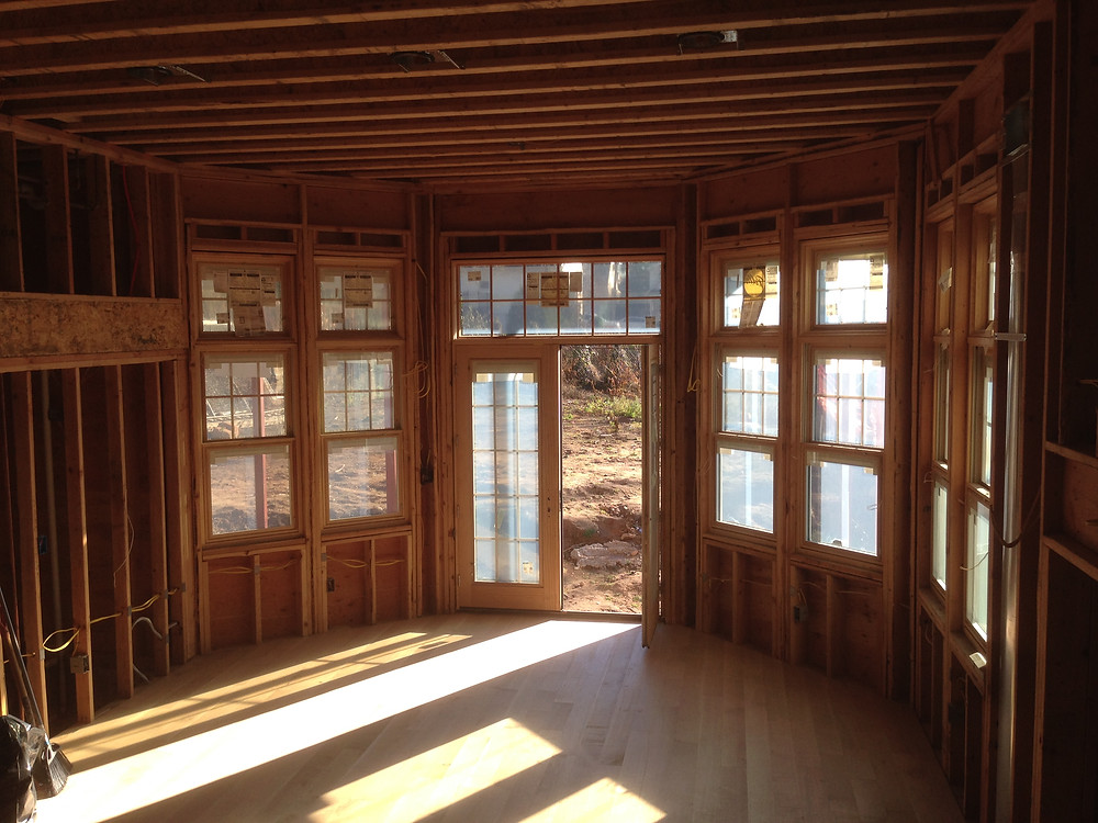 In-progress construction photo of Great Room looking towards new French doors and new windows.