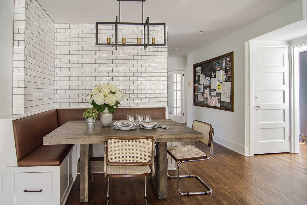Breakfast banquet, subway tile walls, rubbed bronze light fixture, storage in bench.