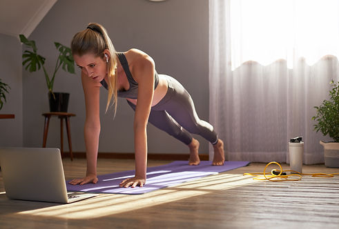 Young woman taking part in online fitnes