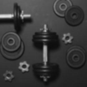 Dumbbells or weights on black table - Co