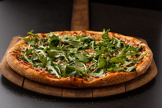 Pizza arugula prosciutto