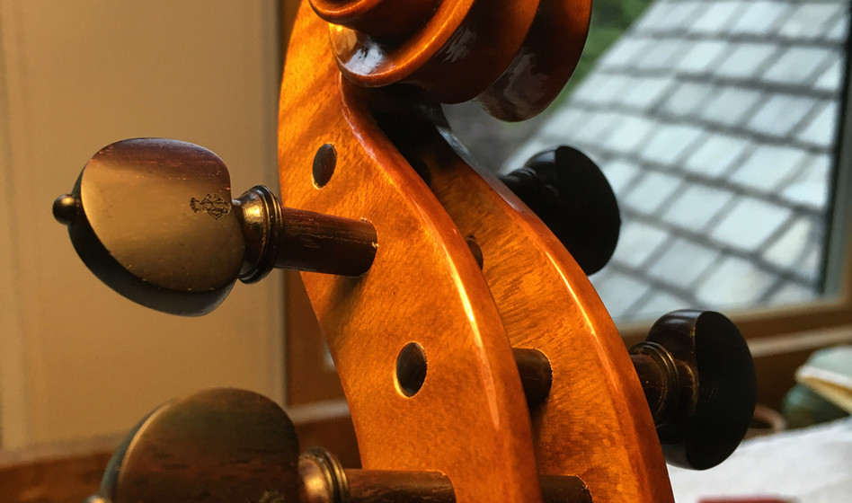 Completed installation of rosewood pegs.