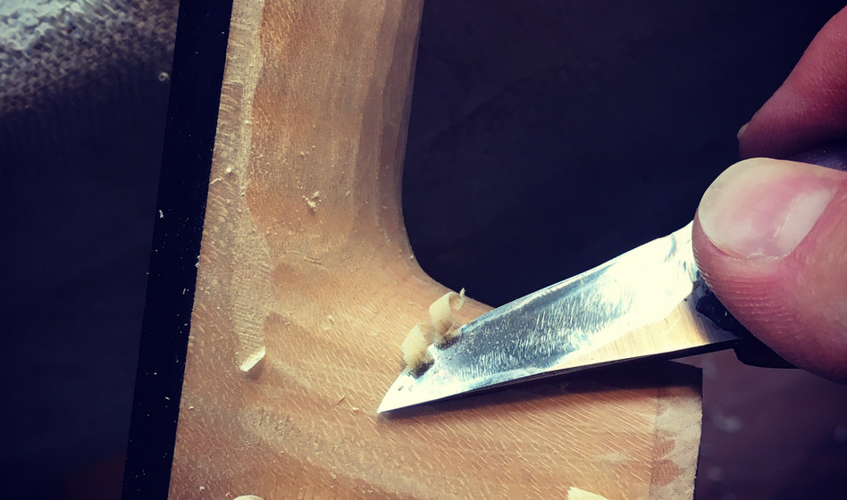 Trimming the neck heel and handle to the finished dimensions.