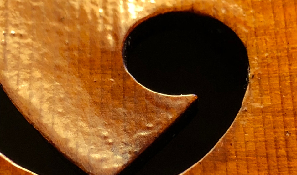 F hole showing varnish texture.
