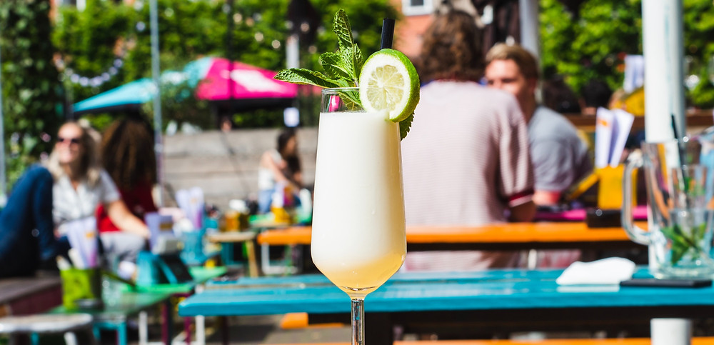 tropical drink sitting on a picnic table
