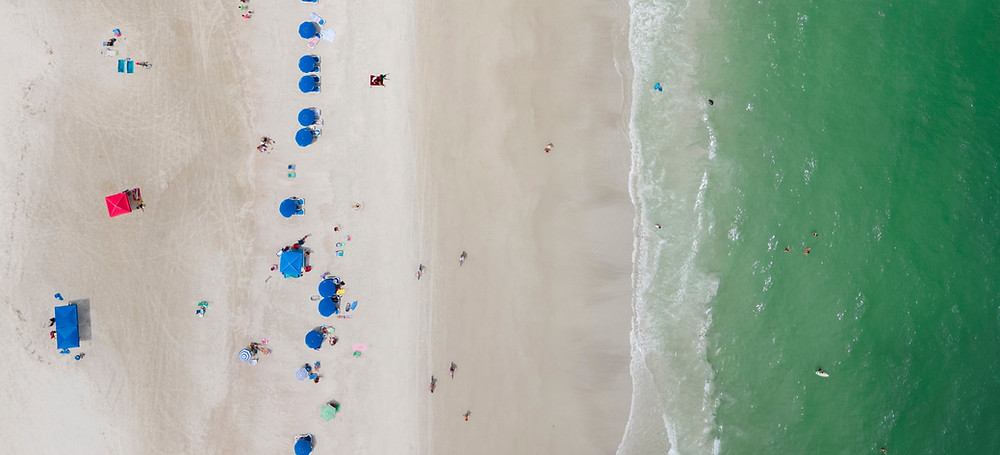 Aerial view of a beach with sun chairs
